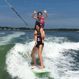 Daisy Seigal - Wakesurfing with Peconic Water Sports Kids Camp near Shelter Island in the Hamptons in Long Island, New York