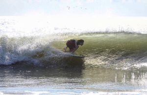 Luke Weinstein, of Peconic Water Sports, surfing near his home in East Hampton, Long Island, New York